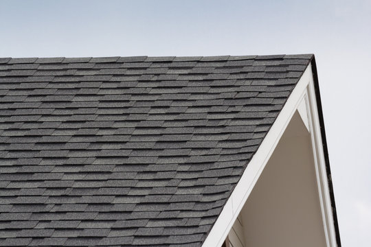 grey and black roof shingles of house