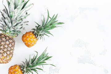 Pineapples on white background. Flat lay, top view, copy space