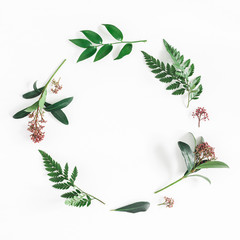 Flowers composition. Wreath made of tropical flowers and leaves on white background. Flat lay, top view, copy space, square