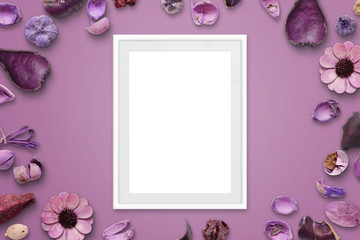 White picture frame on pink background surrounded with flower decorations.