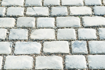 Road paved with cobble stones for your background
