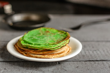 Green pancakes - hot, fresh and delicious