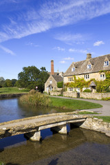 The idyllic Cotswold stone riverside cottages of Lower Slaughter in autumn sunshine, Gloucestershire, UK