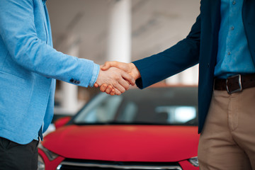 Close-uo of shaking hands after a successful car buying