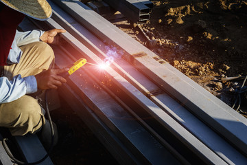 Man worker welder piping in welding and pipe background in construction.