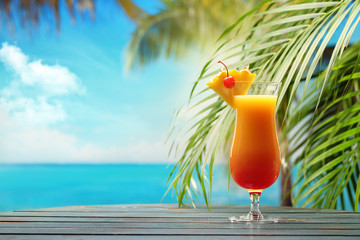 refreshing fruit cocktails on the beach background