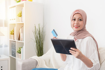 pretty young muslim woman holding mobile pad