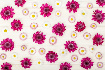 floral pattern made of garden flowers chrysanthemums on white wooden rustic table background. vintage card, flat lay, top view. summer floral concept