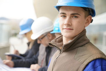 Portrait of young man in construction industry training