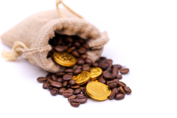 Close up golden coin on coffee bean,business and coffee concept.