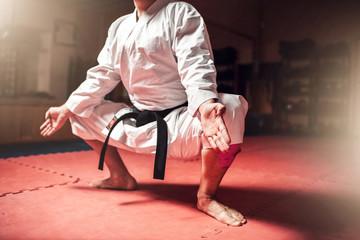 Martial arts master meditation training in gym