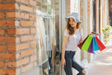 Concept of woman shopping and holding bags.