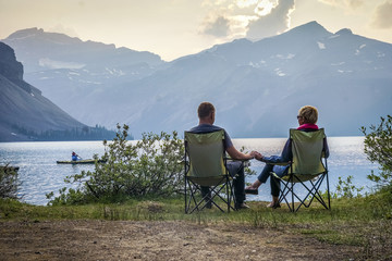 Young couple relaxing by Bow Lake  in Alberta, Canada