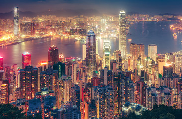 Zelfklevend Fotobehang Hong-Kong Scenic view over Hong Kong island, China, by night. Multicolored nighttime skyline with illuminated skyscrapers seen from Victoria Peak
