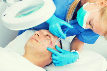 Woman doctor is doing mesotherapy for adult client