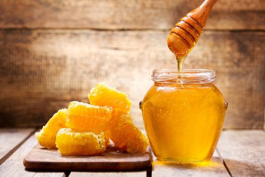honeycombs and jar of honey