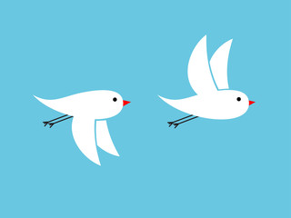 White birds flying on blue background waving their wings upwards