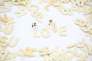 love word picking up by couple