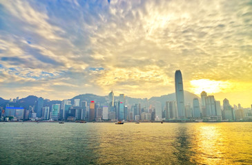 Victoria Harbor and Hong Kong skyline at sunset.