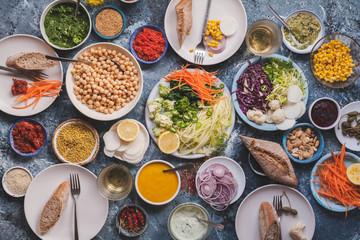 Cereals grains ingredients bulgur couscous in glass jars storaje concept