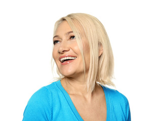 Portrait of smiling mature woman on white background