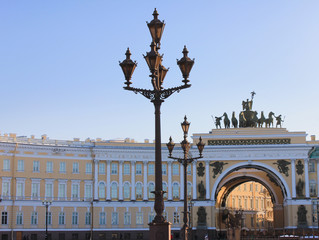 Historical Architecture of Palace Square in St. Petersburg, Russia. Touristic Landmarks of Saint-Petersburg City Center with General Staff Building Ornamental Arch and Decorative Old Street Lanterns.