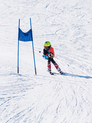 People are having fun in downhill skiing and snowboarding