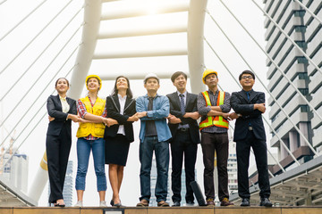 City business and engineer peoples hold  hands together and look up to sky for life vision