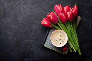 Red tulip flowers bouquet and coffee cup