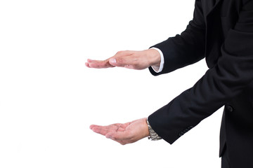 Hands open businessman. Your objects are here. Businessman in a black suit and tie with outstretched hand for implementation of graphic futuristic. Business concept , Graphic, Golography, Product.
