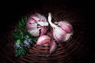 red garlic with a rosemary branch