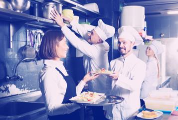 Waitress in restaurant kitchen