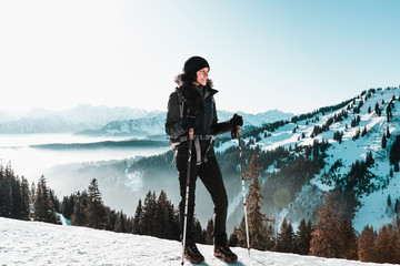 Fotomurales - Young smiling woman hiking in snowy mountains