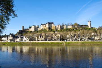 Chinon town with its chateau on the hill above in spring afternoon sunshine on the banks of the River Vienne, Indre-et-Loire, France