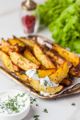 Delicious roasted potatoes garnished with parsley. Baked potato