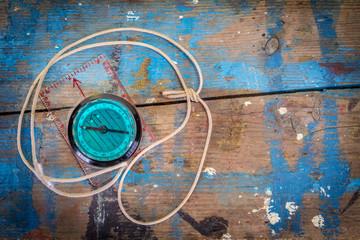 Vintage Compass on Paint Splattered Wood