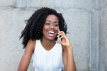 Beautiful african american woman at cellphone