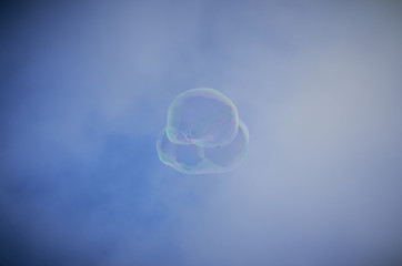 Soap bubble floating with clouds and blue sky in Barcelona