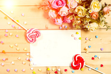 Beautiful valentines day background with sweet hearts on wooden background