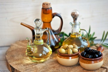 bread with olives and olive oil, olive oil in bottles