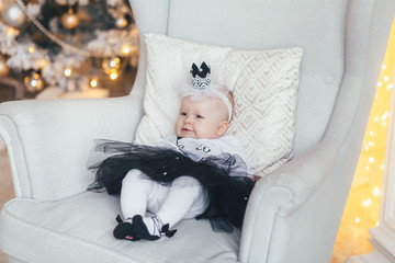 The small girl lies on the chair