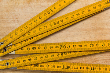 Measuring Stick on a Wooden Table