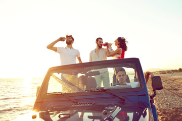 Group of happy friends making party in car - Young people having fun drinking champagne