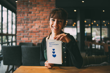Young Woman Holding Heart Shaped Notebook on Valentine's Day