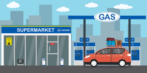 Gasoline fuel station,red car with luggage on the roof