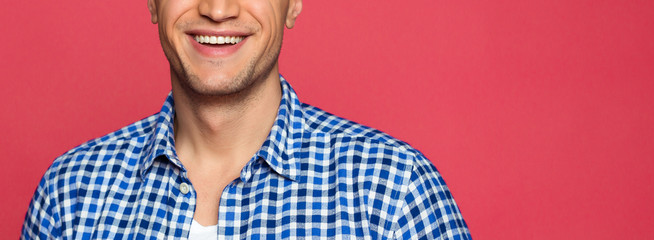 Close up Photo of a beautiful white male smile. Healthy and clean teeth
