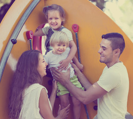 Young Parents with children at playground's