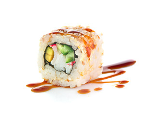 Sushi roll isolated on white background. California sushi roll with tuna, vegetables and unagi sauce closeup