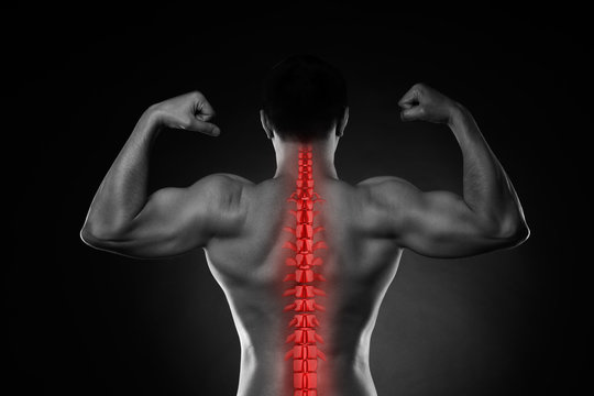 Pain in the spine, a man with backache, injury in the human back