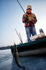 Winter season- Fisherman catch fish on the river